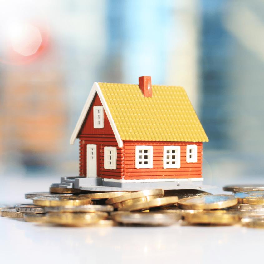 visual image of small house figurine balanced on coins